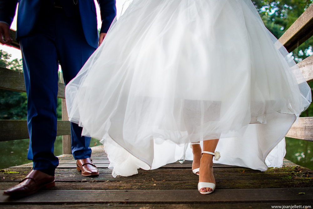 close up of bride and groom's shoes