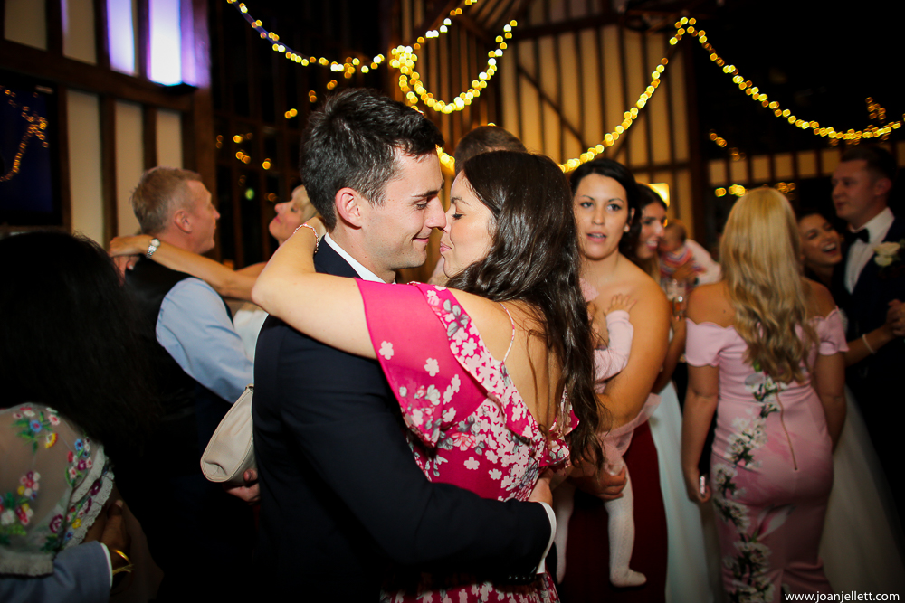 guests dancing and kissing