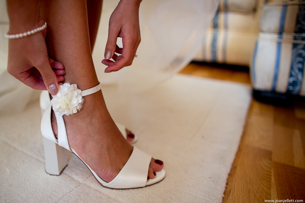 bride putting her shoe on