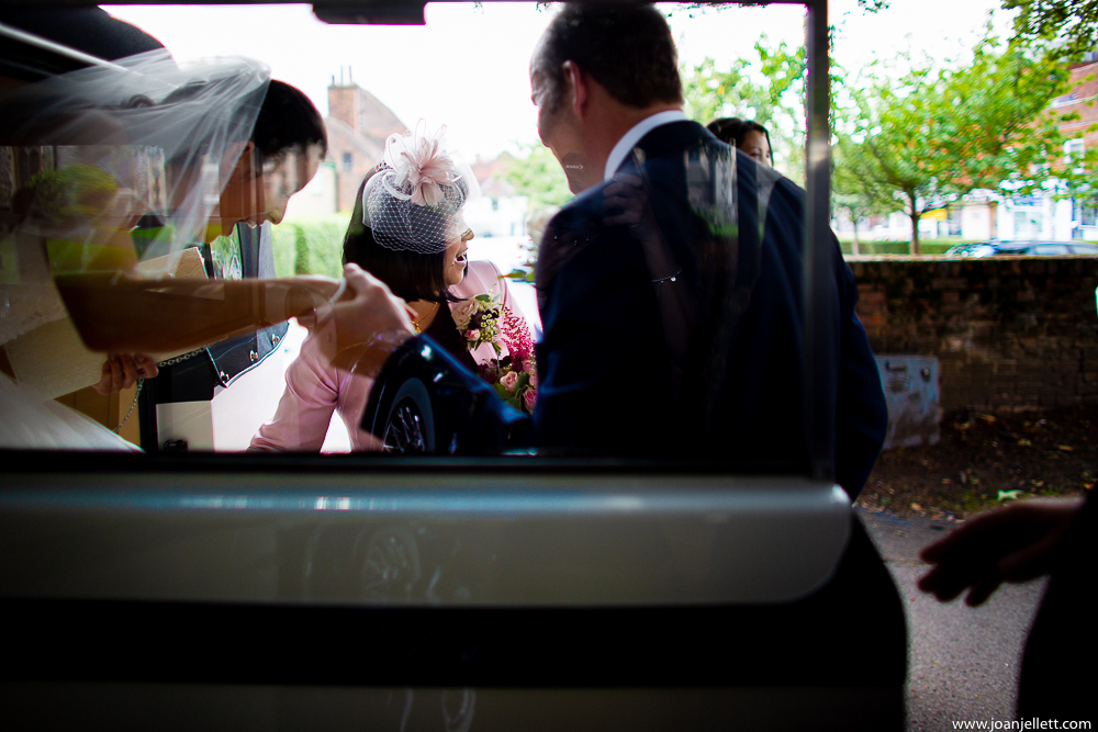 bride getting off her car at the church