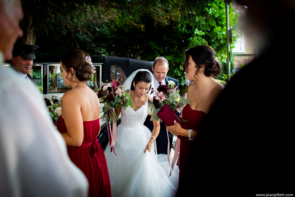 bride grabbing her dress as she goes down