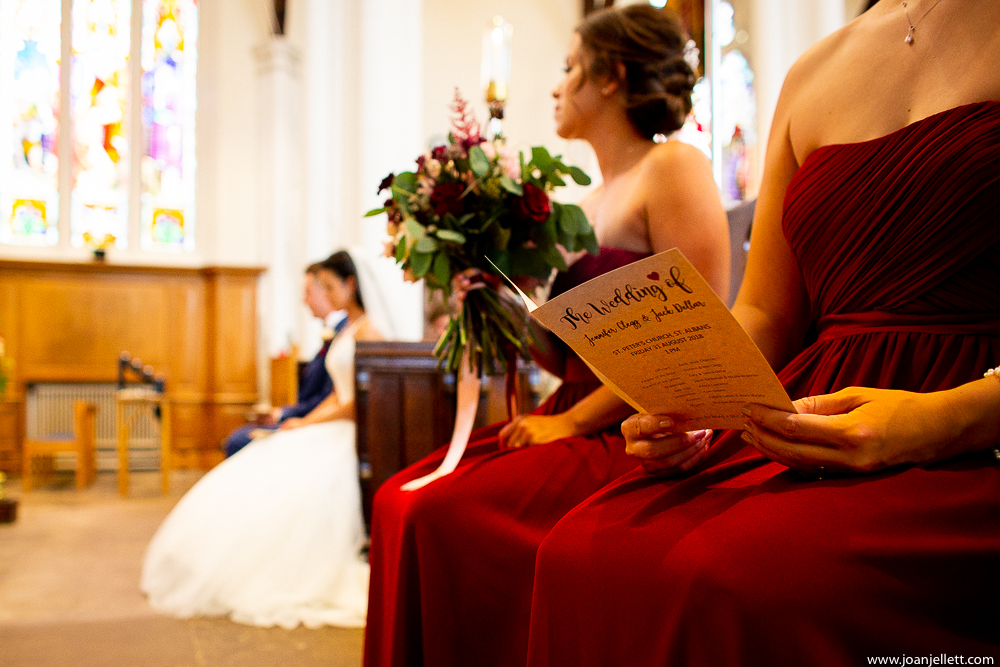 leaflet and bride and groom in the background