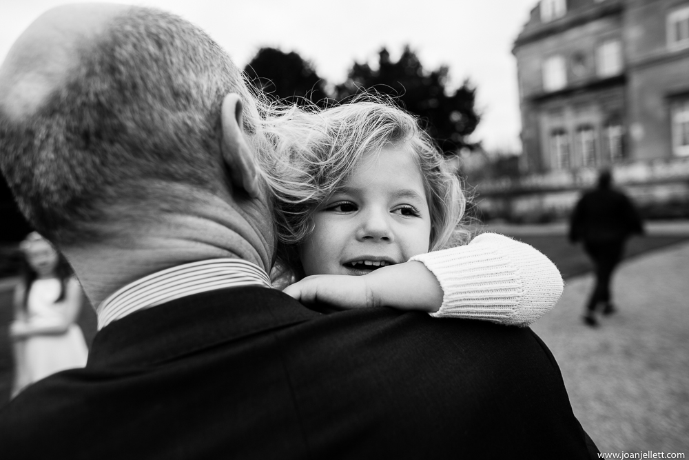 Little girl cuddling father at the Luton Hoo