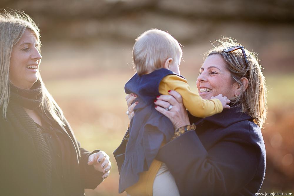 Mum holding baby in Richmond park