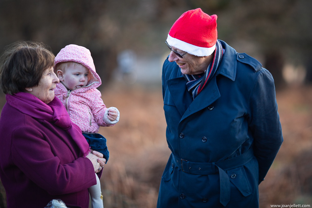grandad wearing a funny Christmas hat smiling