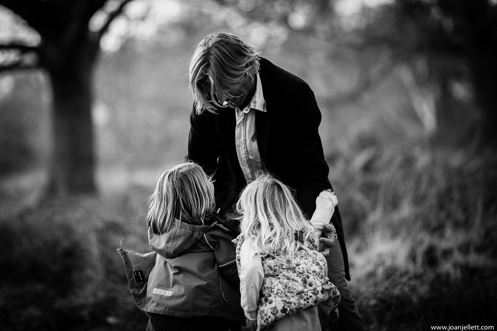 daddy and his two girls in black and white