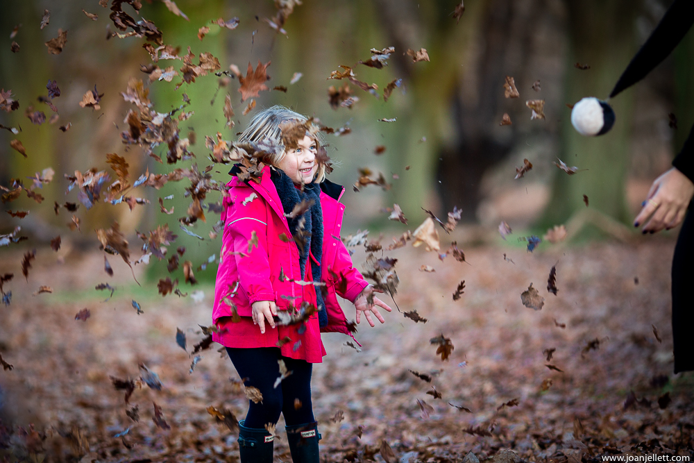 little girl throwing leaves in Richmond Park