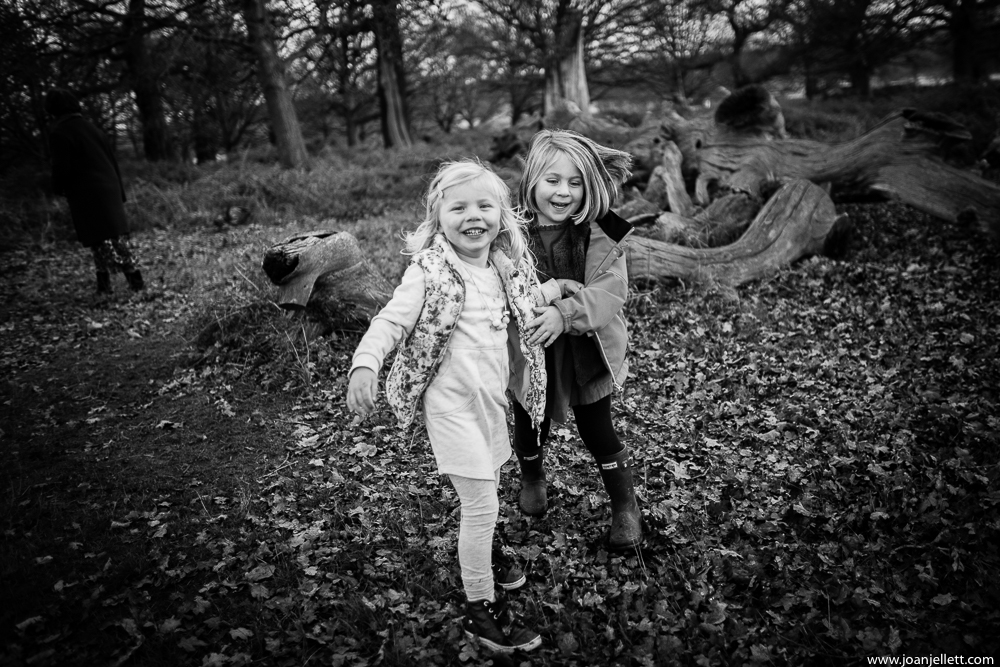 two little girls smiling in Richmond park