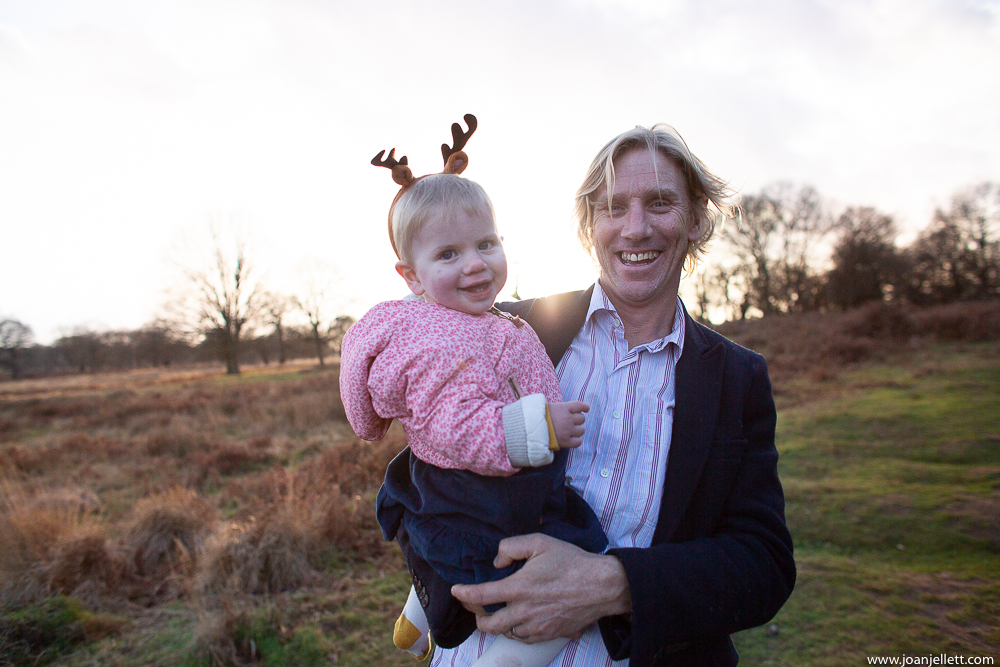 dad and baby wearing funny festive headgear