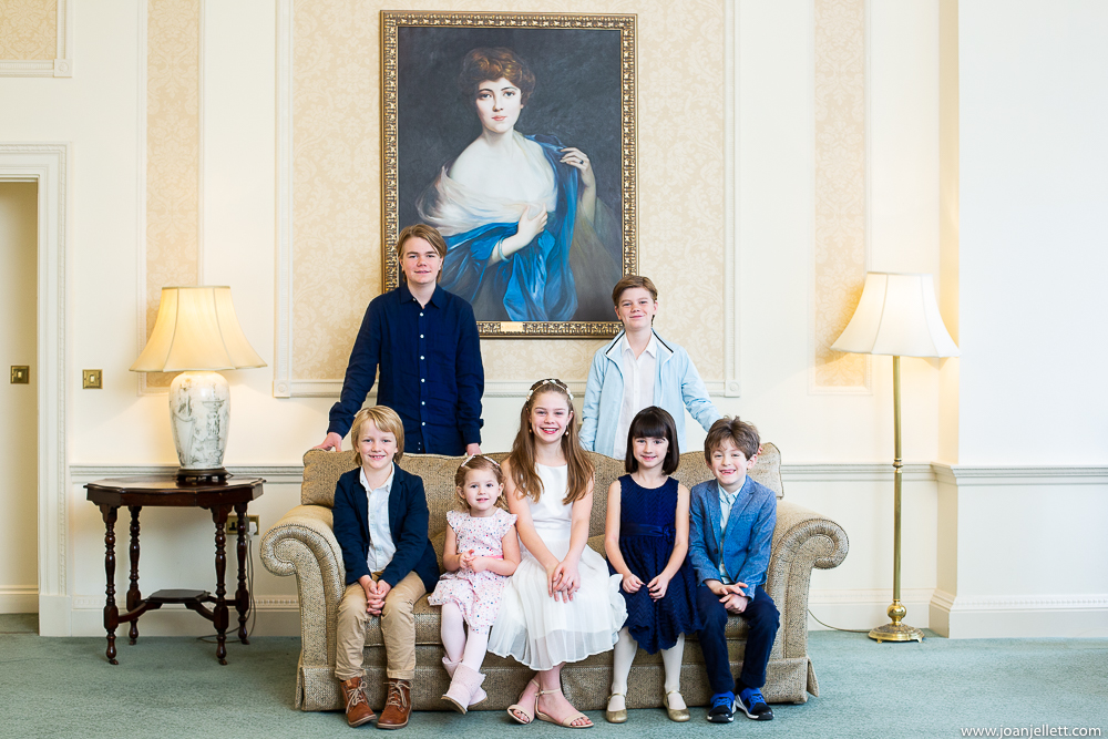 Grandchildren smiling and sat on sofa at the Luton Hoo