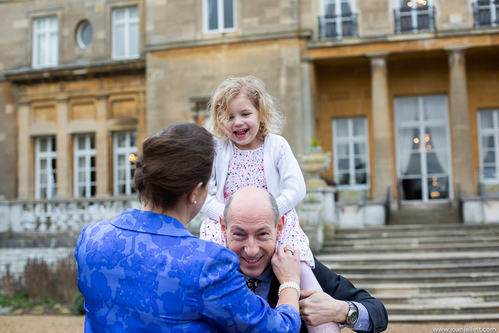 Little girl on shoulders smiling at the Luton Hoo
