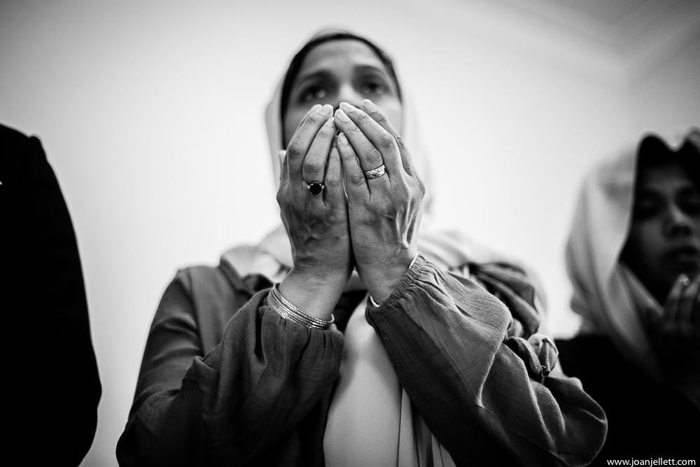 detail shot of praying hands