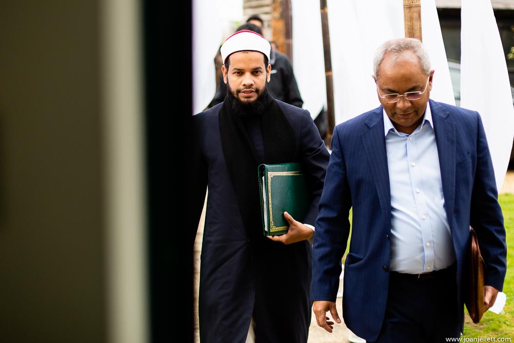 imam walking down the path