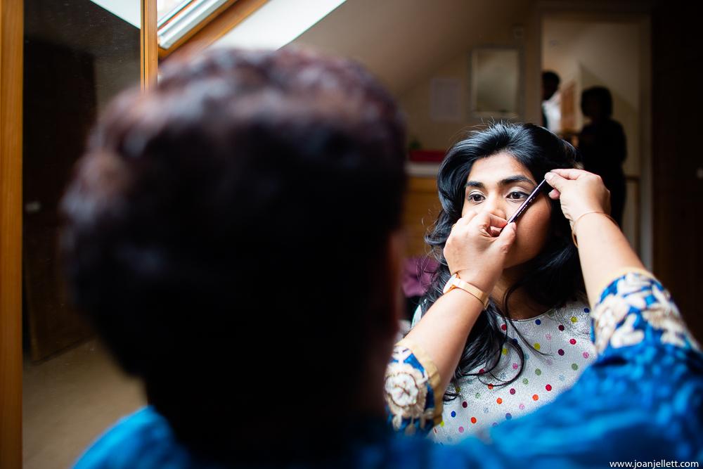 bride having her eye makeup done