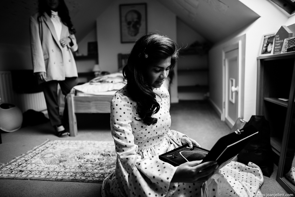 bride opening her gift from the groom