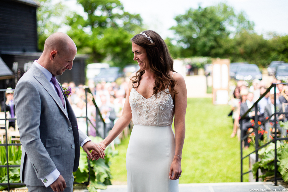 groom holding bride hand