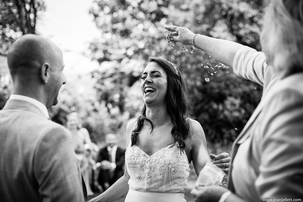 black and white shot of bride in confetti