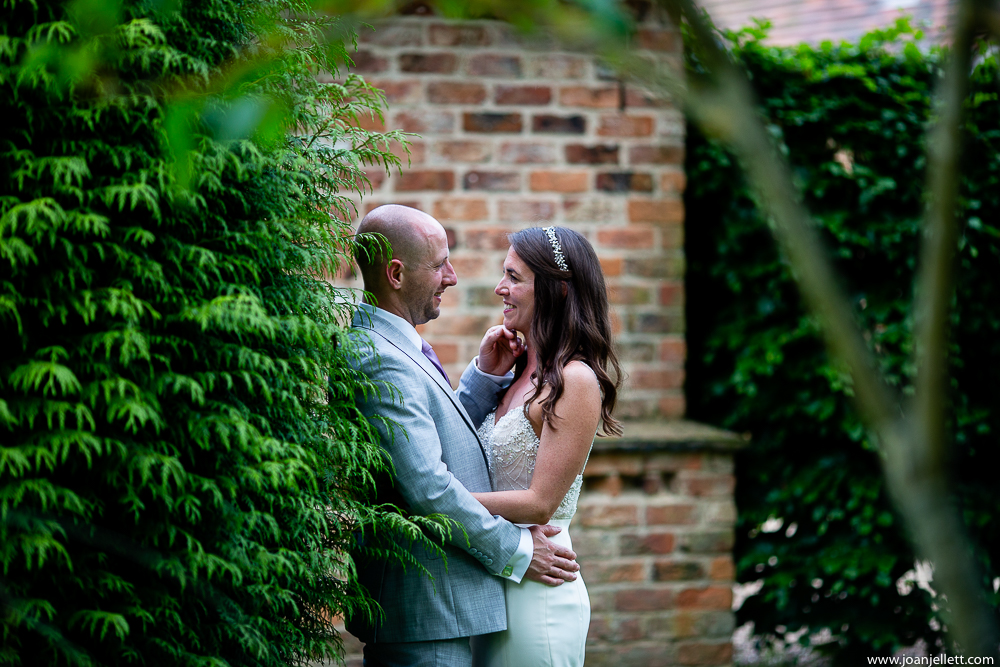 bride and groom portraits at their farmhouse at redcoats wedding