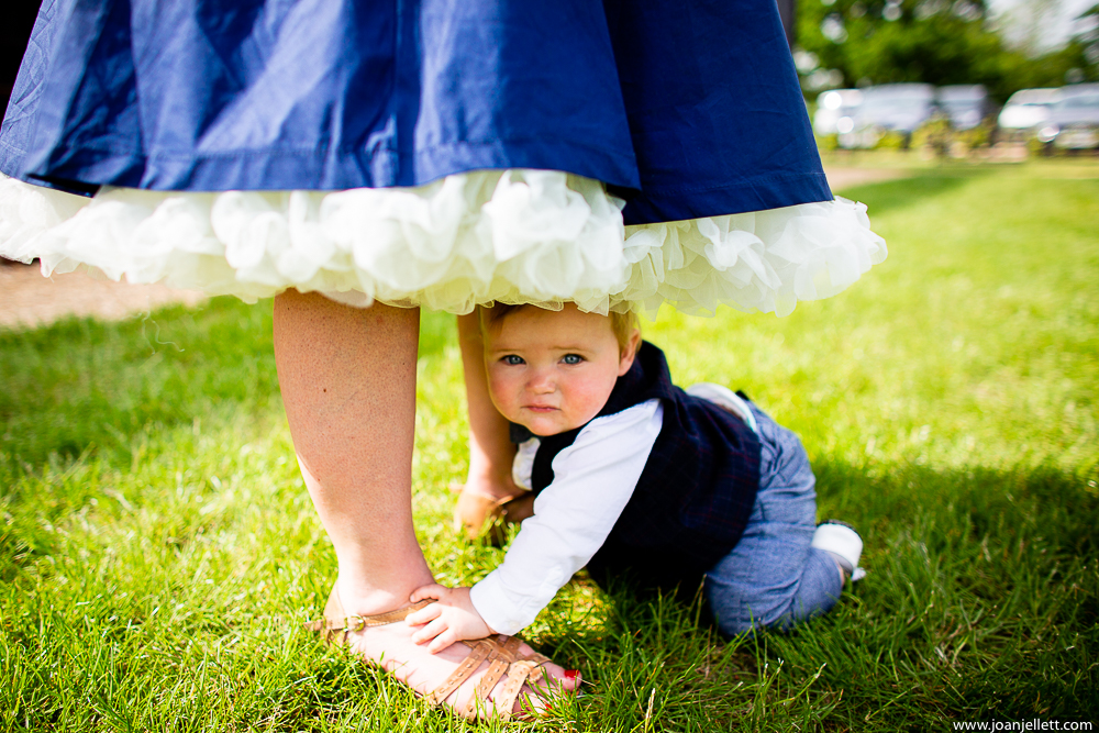baby at guests feet