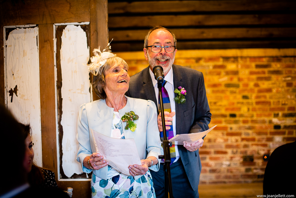 mother and father of the bride reciting a poem