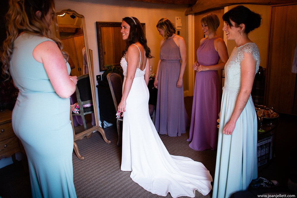 bride putting her dress on farmhouse at redcoats