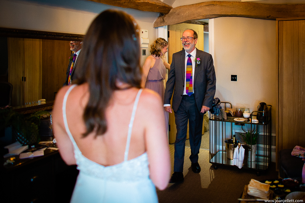 Father of the groom seeing his daughter in her dress for the first time