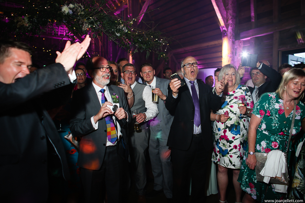 guests cheering the cake cutting