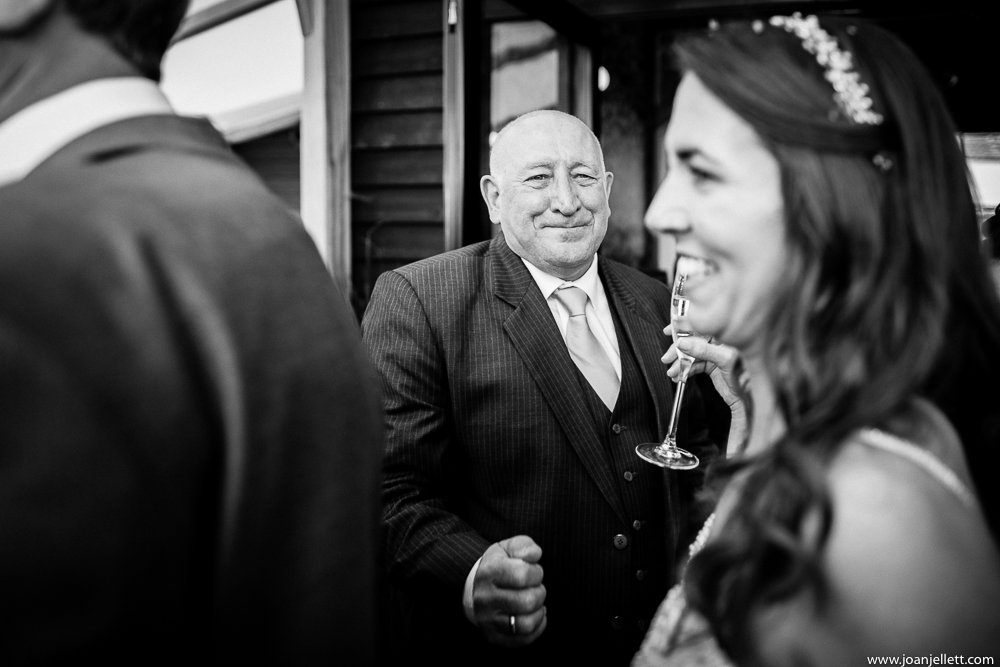 Father of the bride in black and white smiling at her