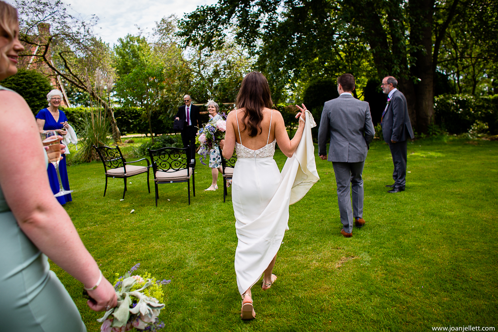 bride walking to her guests
