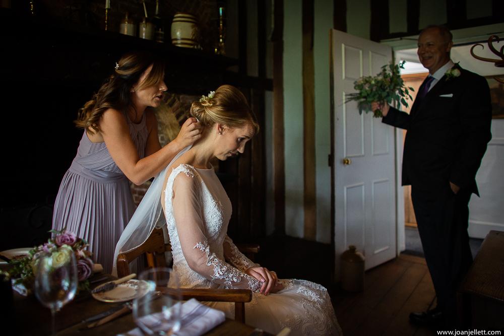 bride having her hair adjusted