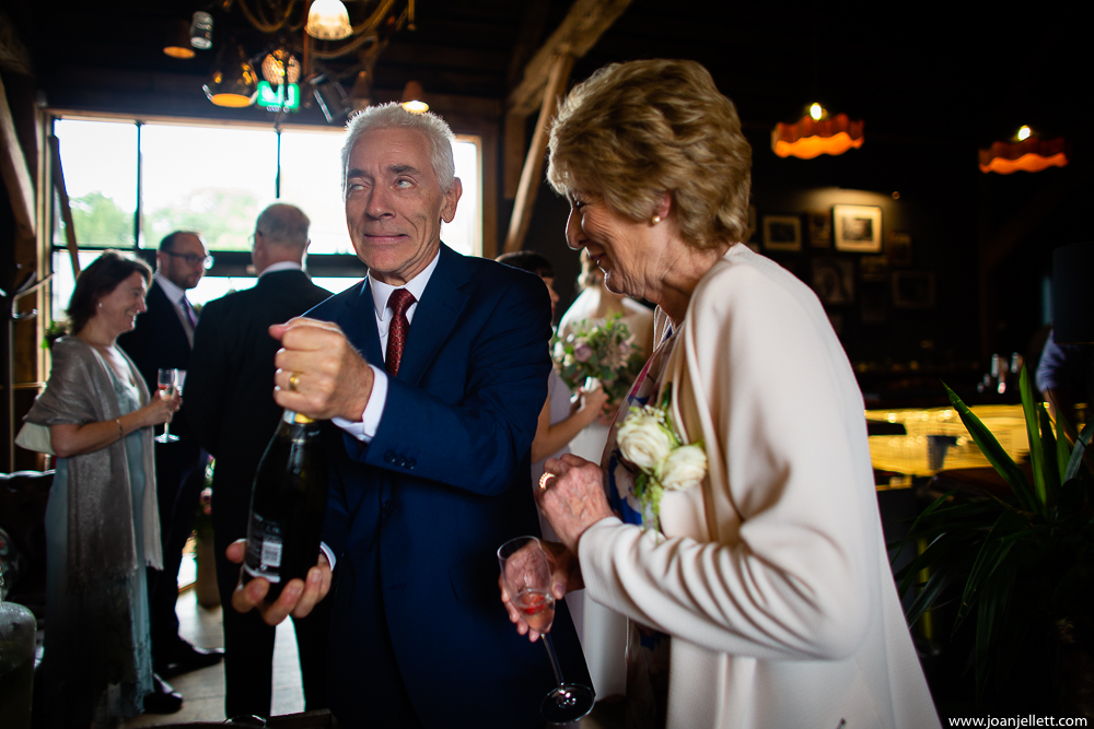 guests opening prosecco bottles