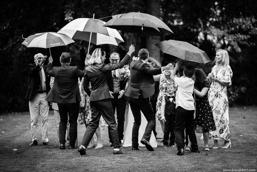 guests under umbrellas