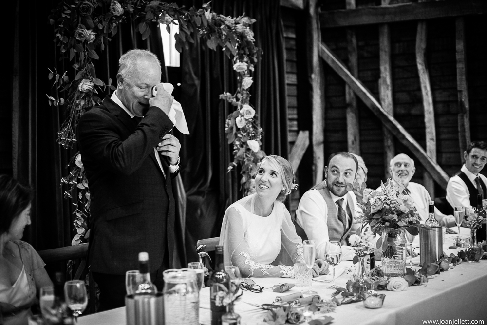 bride looking at her father crying