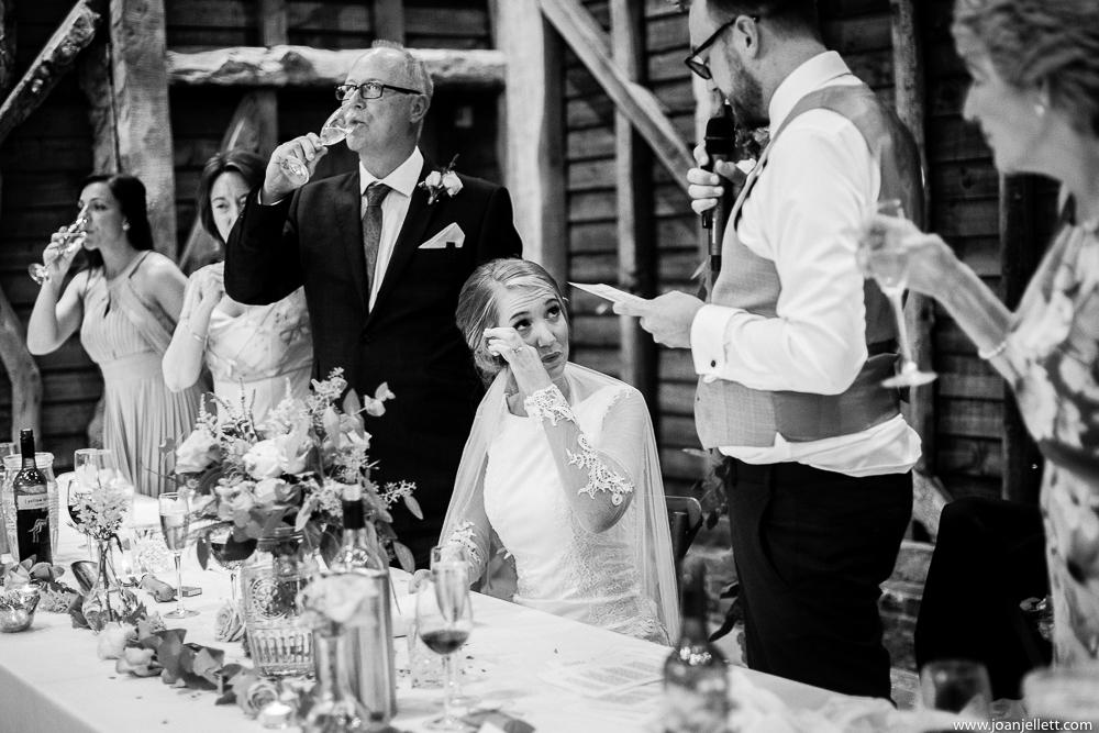 bride crying listening to her groom's speech
