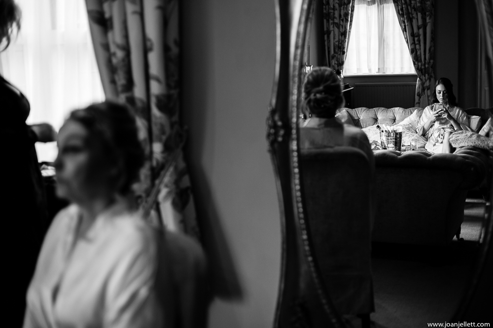 black and white shot of bridesmaid in the mirror