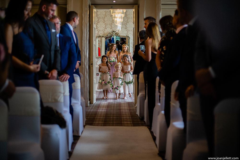 walking down the aisle bridesmaids