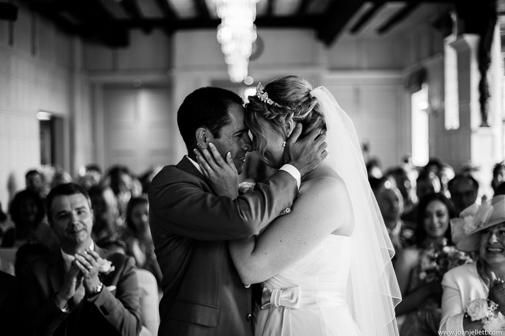 bride and groom kissing in front of everyone