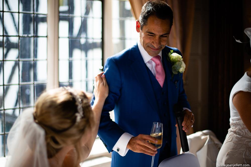 groom winking at his bride