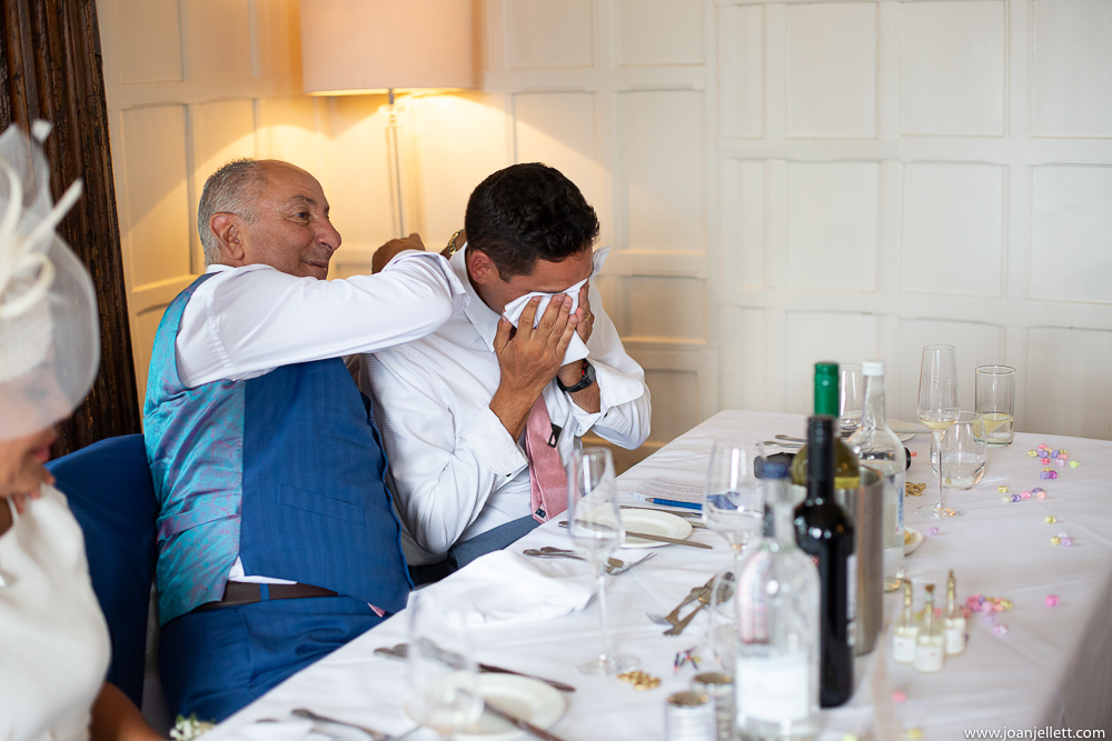 father of the best man hugging him