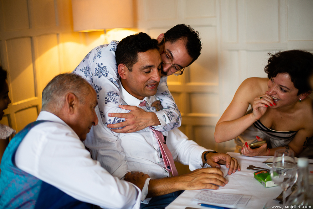 crying best man being comforted