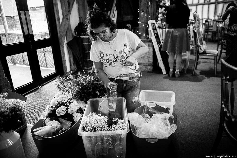 bridesmaid watering flowers