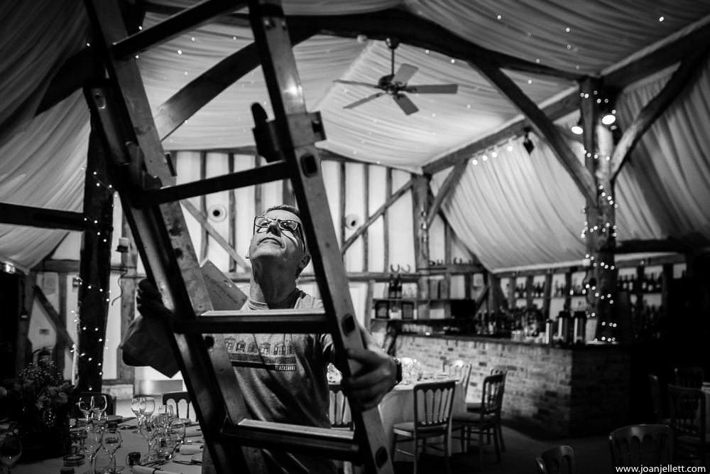 father of the bride on a ladder