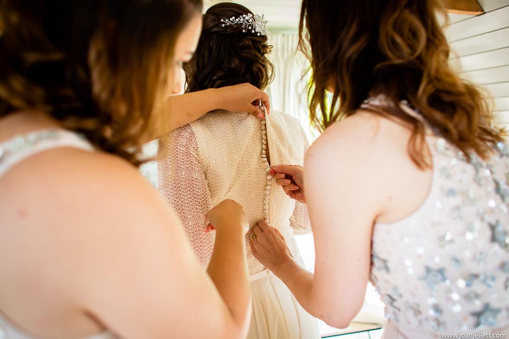 bridal dress being put on