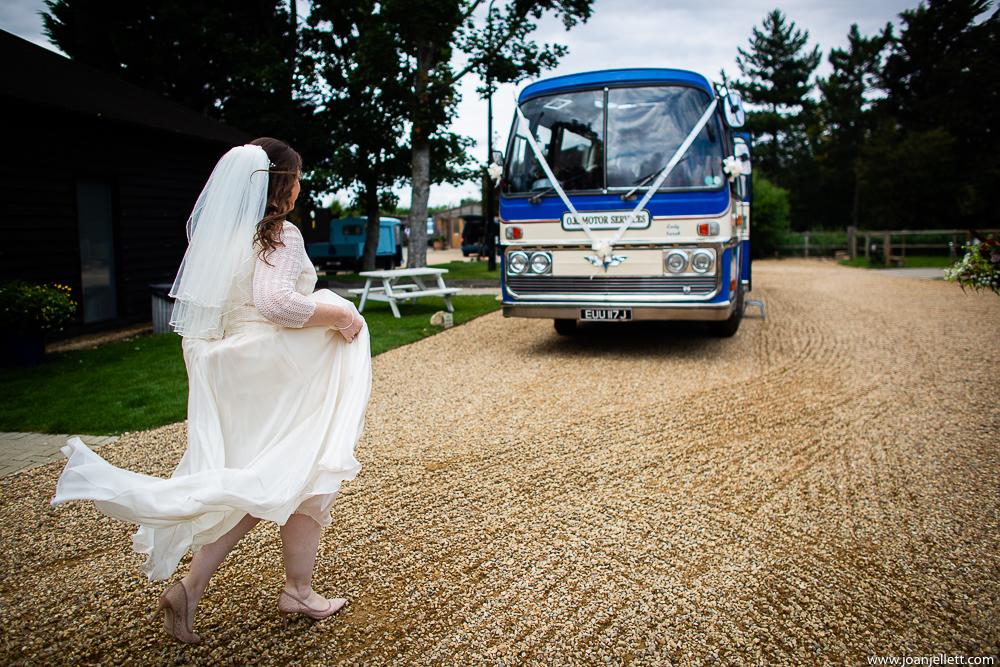 Bride walking towards the vintage bus