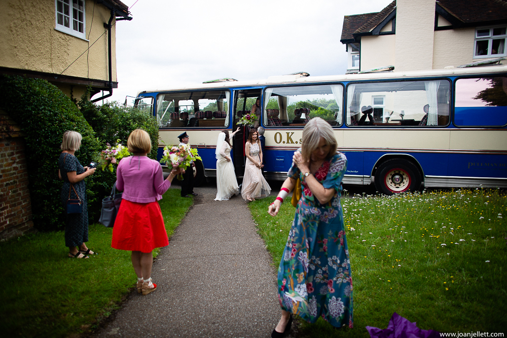 bride coming off the bus