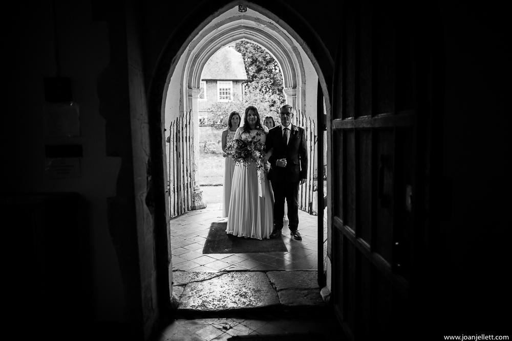 bride waiting for her dad at the door