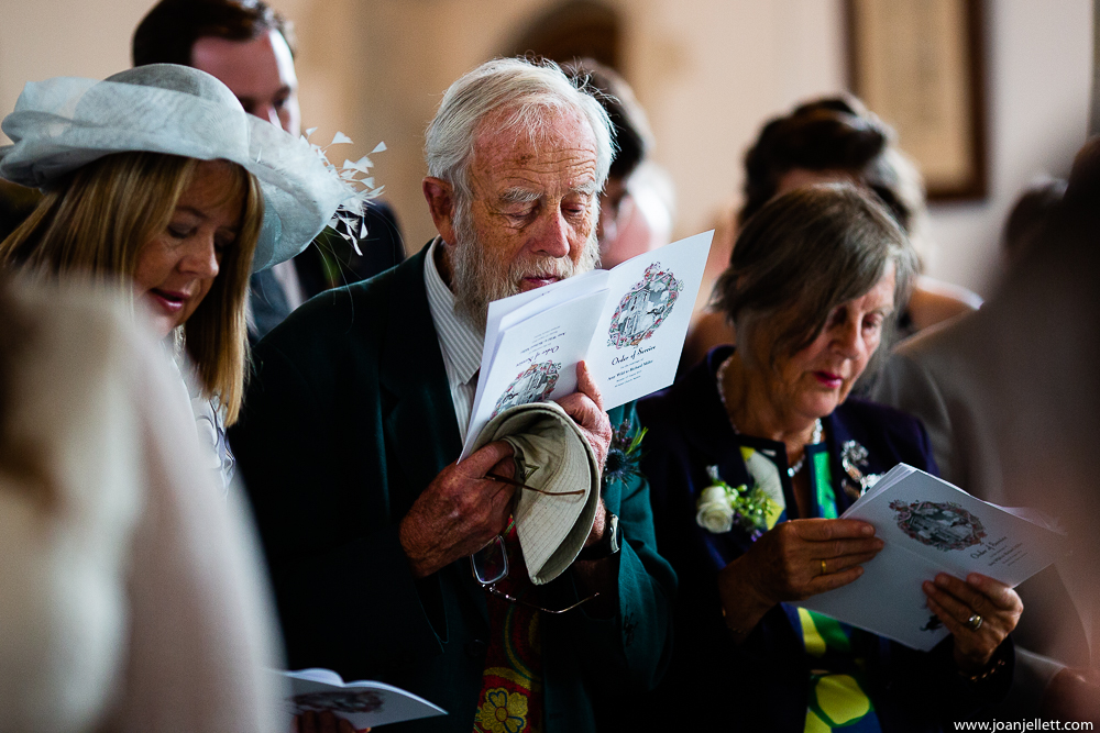 guests reading the order of service