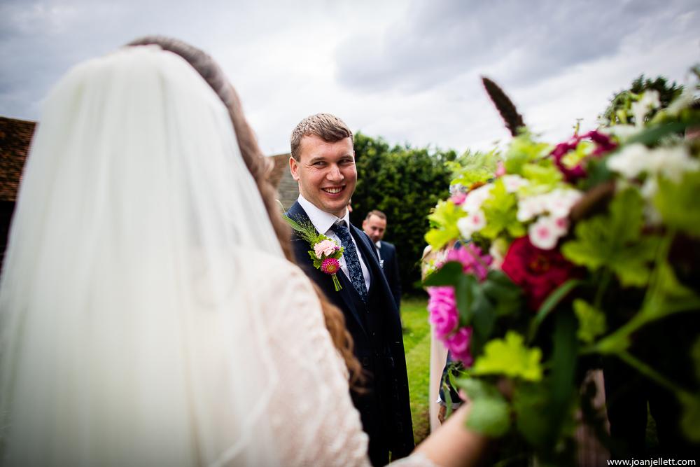 Groom lovingly looking at his bride