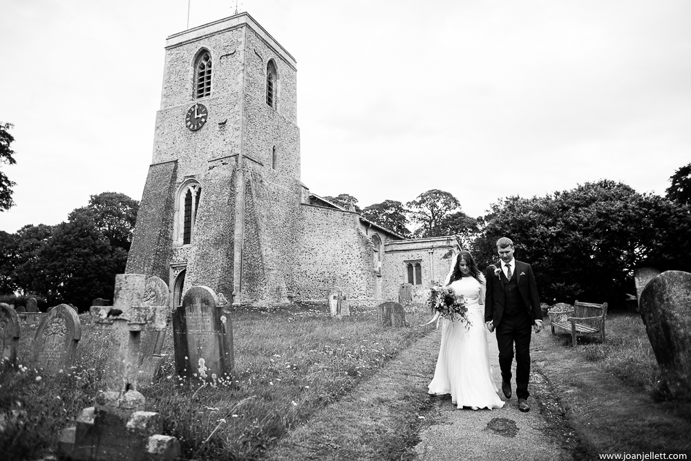 bride and groom walking out of the church
