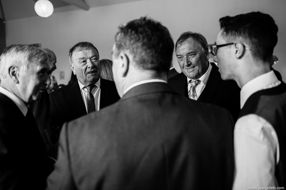 black and white guests looking at eachother